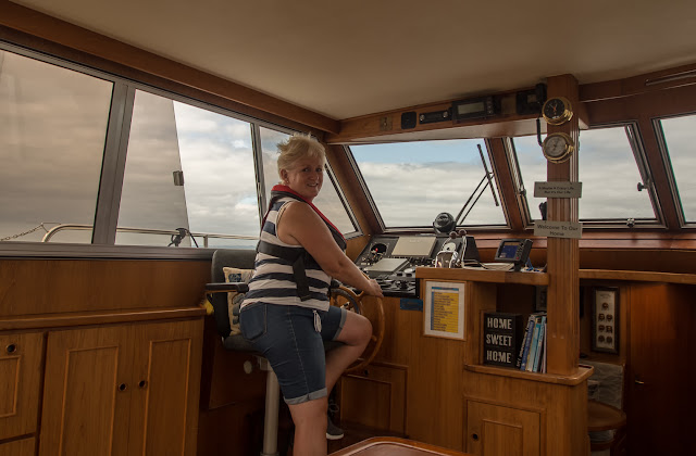 Photo of me at the helm
