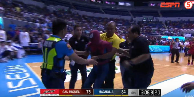 Security personnel rushed to drag 'Spiderman' out of the arena.