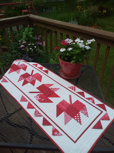 Red and white maple leaf quilted table runner