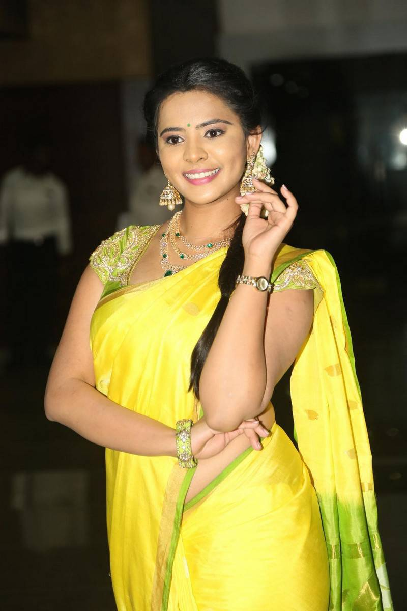 Actress Manasa Stills in Yellow Saree at Film Audio Launch