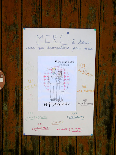 Homemade poster on a garage door thanking key workers during the Covid-19 lockdown.  Indre et Loire, France. Photographed by Susan Walter. Tour the Loire Valley with a classic car and a private guide.
