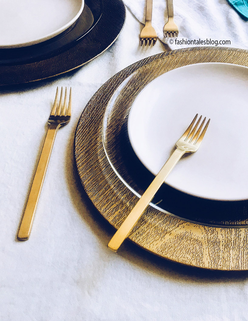 Gold flatware on white plate