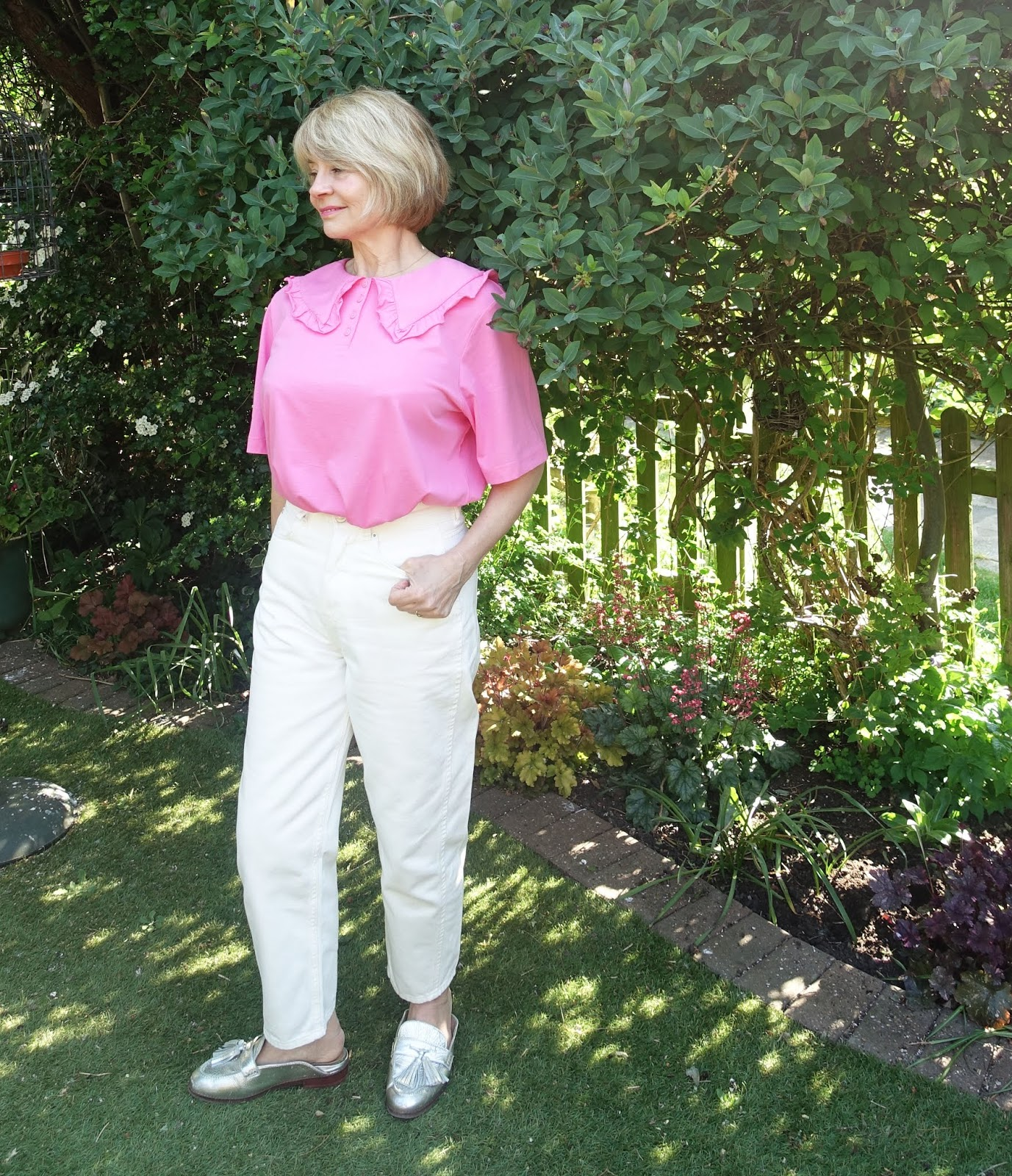 Over 50s blogger Gail Hanlon in summer 2020 essential, a statement collar top, perfect for video calls, worn with white jeans and backless silver loafers
