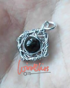 Wire wrapped pendant with black agate on his palm