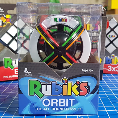 Rubik's Orbit pack shot showing round ball shaped rubik cube with coloured sections