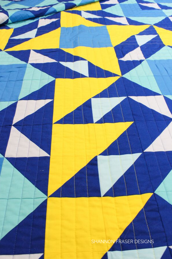 Straight line stitching detail on the Double Windmill Quilt | Modern quilt pattern by Shannon Fraser Designs #quilting #stitches #aurifil #quilts