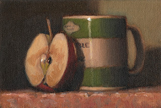 Oil painting of an apple half resting on a green and white porcelain mug.
