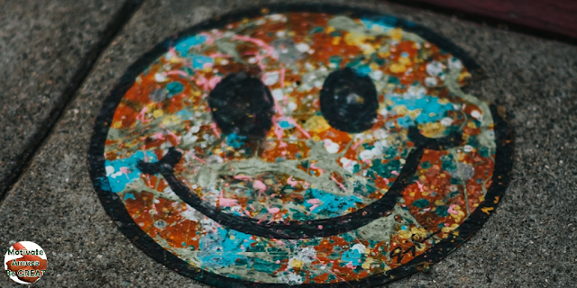"Featured in the article: ""Art Therapy Benefits For Mental Health Improvement "". Represents a artwork of a colored smiling face, how art can boost your self esteem."