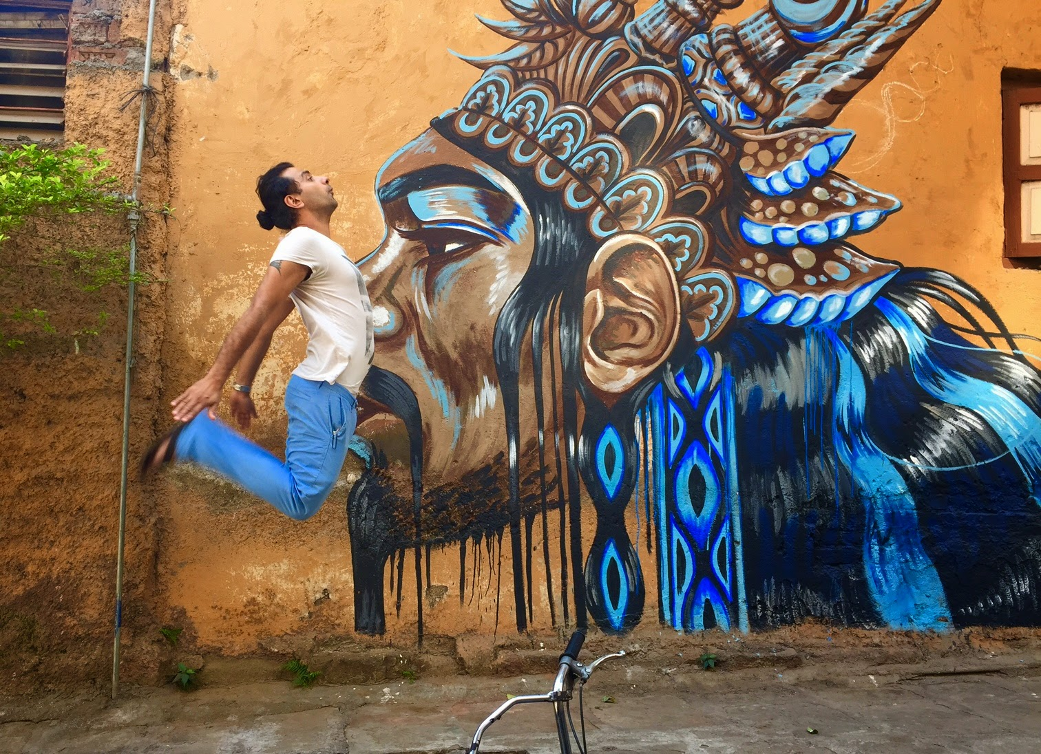 Pune Street Art Project Mural Kasba Peth Kelly Darragh jumping