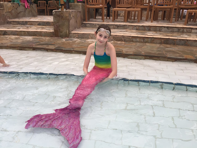 Sasha in pool at Center Parcs with mermaid tail