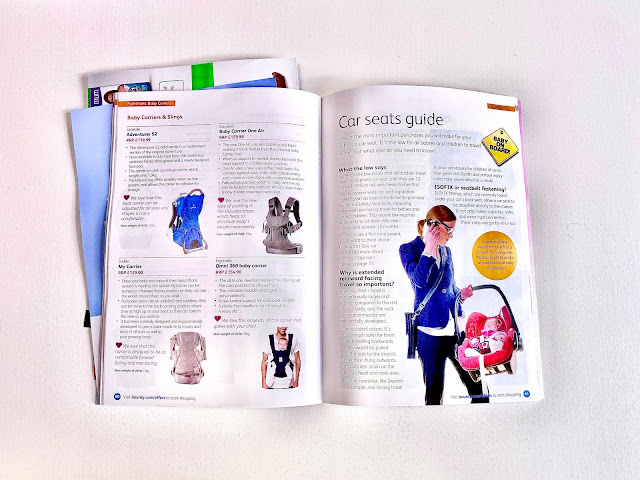 An A5 magazine open at a page showing a selection of baby carriers and a car seat guide