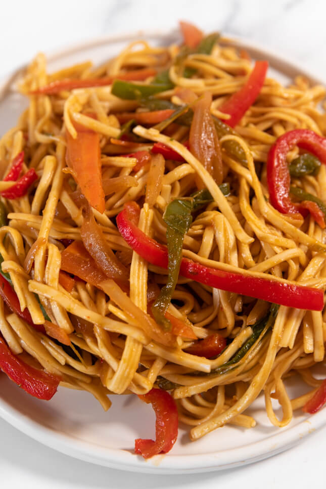 Close up photo of a plate of noodles with vegetables