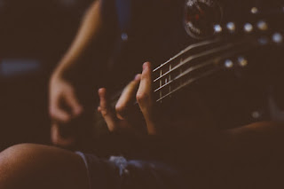 Canva - Person Playing Guitar