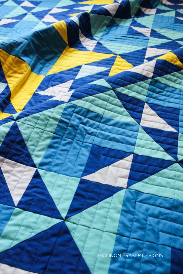 Blue stitches on the Double Windmill Quilt | Modern Quilt Pattern | Shannon Fraser Designs #quiltingdetails #straightlinequilting #aurifilthread