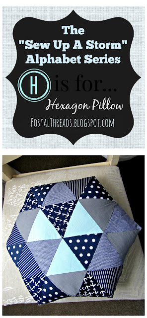 navy, aqua, gray & white color scheme; triangles are pieced together to form a hexagon, pillow used for plain desk chair cushion