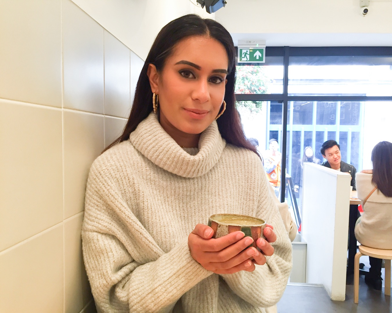 London blogger Reena Rai enjoying a Hojicha latte at Kova Patisserie in Soho