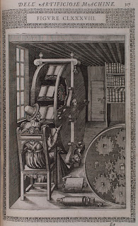 An illustration of a man seated at a book wheel.