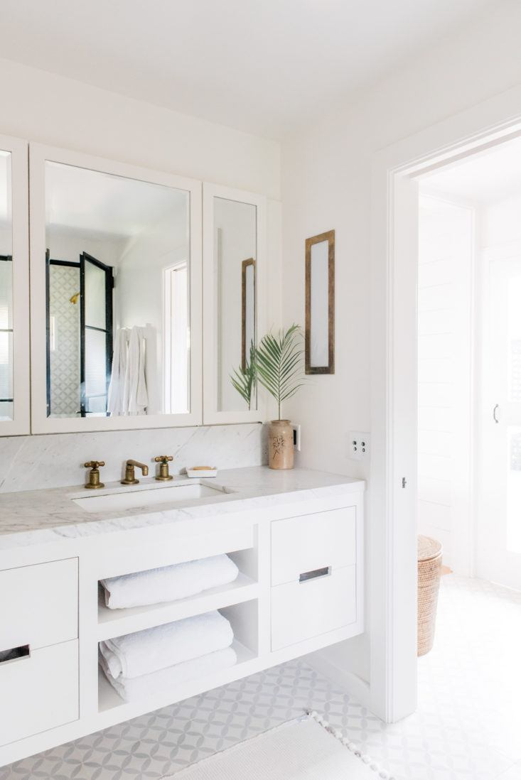 Floating white vanity in bathroom of beautiful oceanfront cottage on Maui - found on Hello Lovely Studio