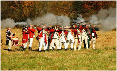 British reenactors fire muskets at Hope Lodge encampment
