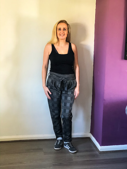 New wardrobe additions from Femme Luxe - tartan print trousers with vest and trainers