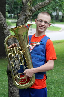 Boy with a tuba wearing a Cool Kids adjustable cooling vest