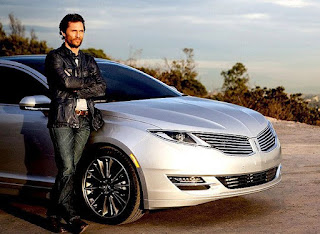 Pat McConaughey's brother Matthew posing for picture with car