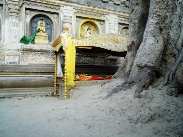 This is the Vajrasana or the Diamond Throne of enlightenment under the Bodhi Tree at the Mahabodhi Temple, Bodhgaya. It is rectangular stone block built by Emperor Ashoka in the 3rd century BCE. It symbolically denotes the place where Buddha sat for attaining nirvana.