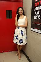 Actress Ritu Varma Stills in White Floral Short Dress at Kesava Movie Success Meet .COM 0087.JPG