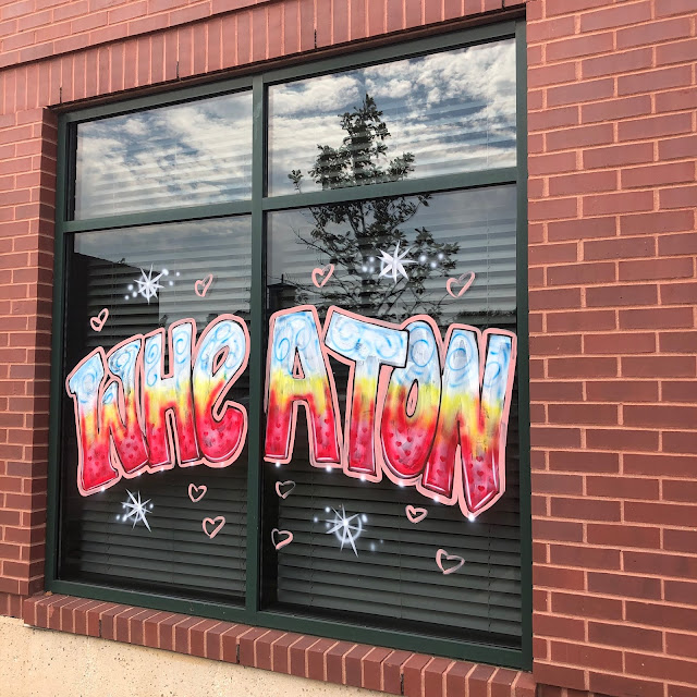 "Wheaton ""Love Where You Live"" Paintings Enliven Storefront Windows."