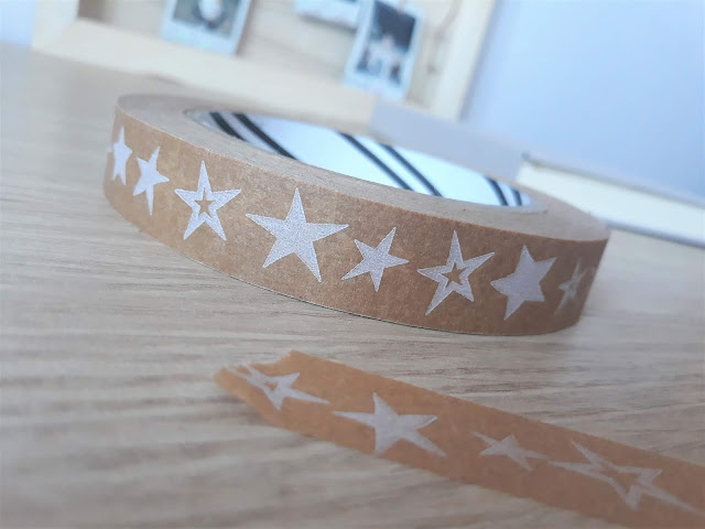 The image shows brown paper tape with white stars on