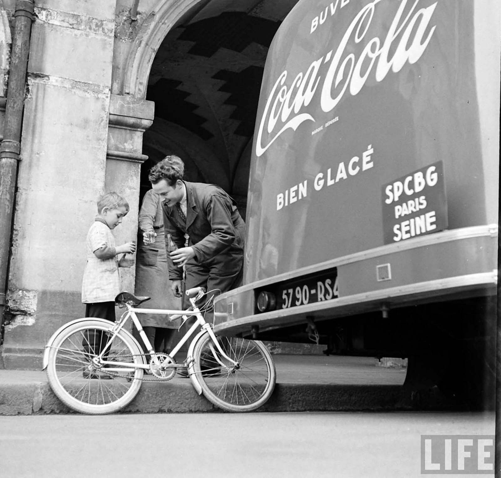 A young boy tasting Coca Cola.