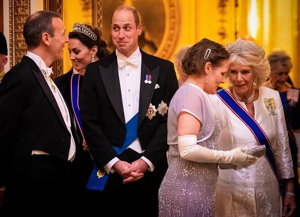 Kate Middleton wore a velvet Alexander McQueen gown, the Lover's Knot tiara, the Nizam of Hyderabad necklace