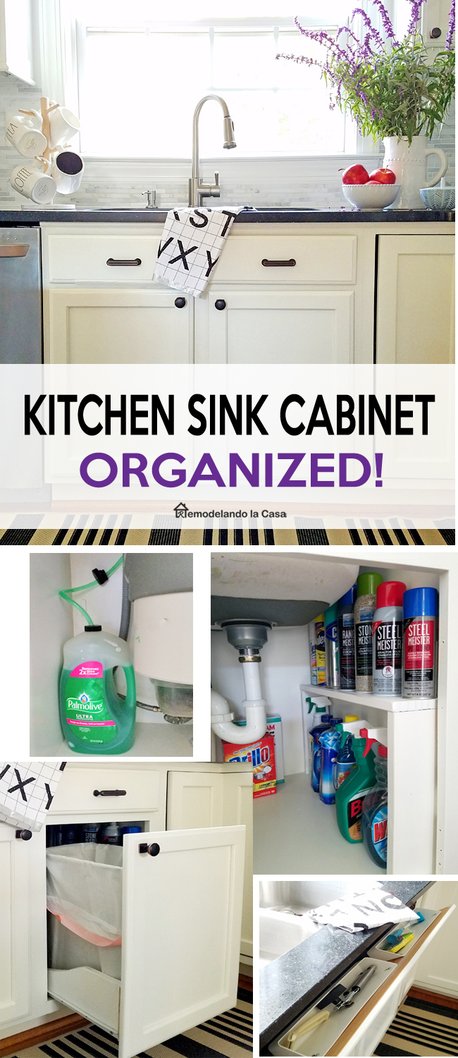 white Kitchen sink cabinet with pull out trash can and endless supply of soap and shelves for cleaning products.