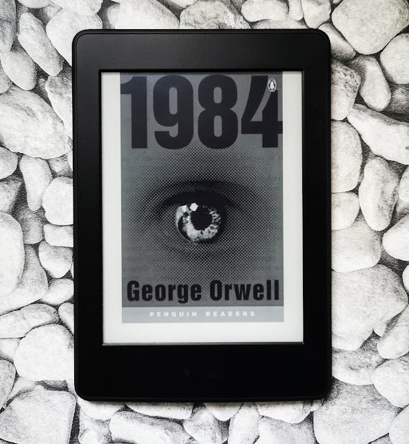 Front Cover of 1984 by George Orwell. Cover shows 1984 in bold type and close up image of Big Brothers eye.