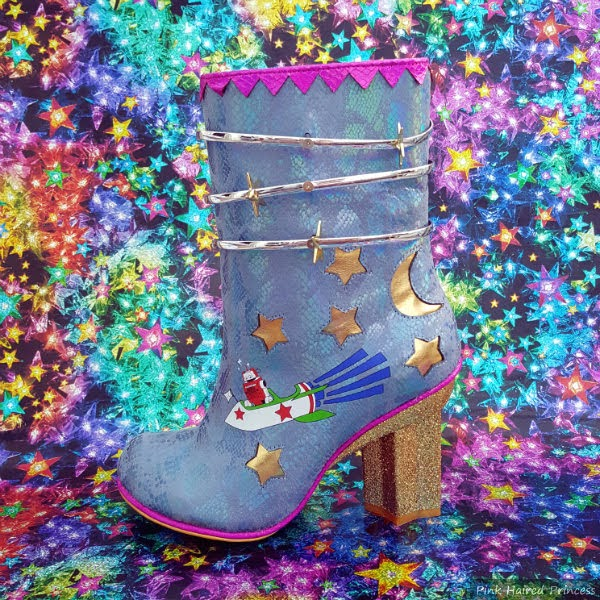 blue boot with silver rings, stars and robot detail on starry background
