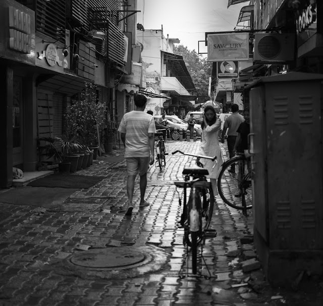black and white street photography at khan market inner lane in new delhi india