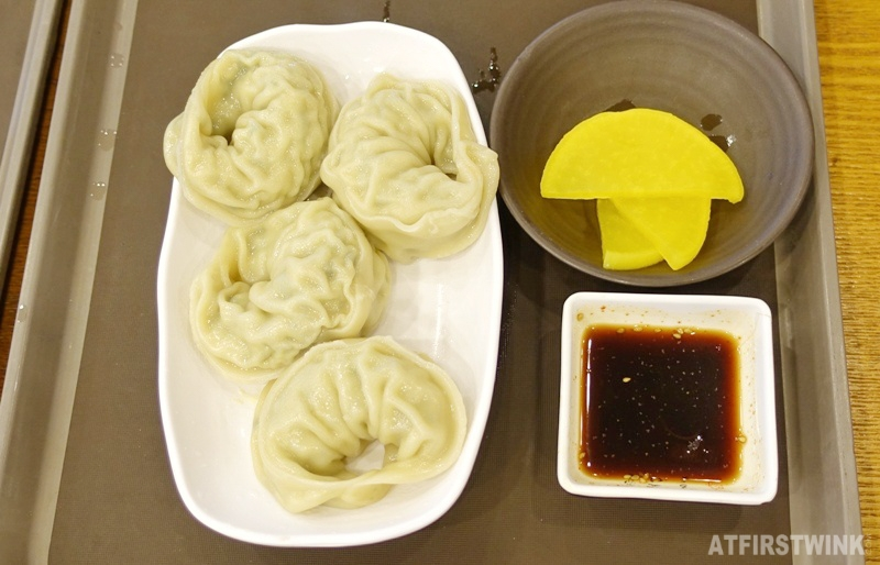 Four king sized dumplings mandy at food court