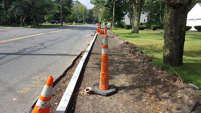 work underway on Chestnut St to add a sidewalk