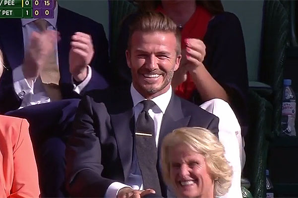 Like a boss: David Beckham deftly caught the ball at Wimbledon