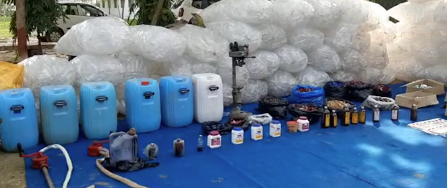13 accused of making poisonous liquor arrested