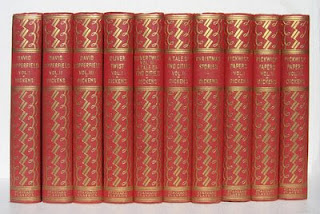 matching set of Charles Dickens books in red covers with gold decoration
