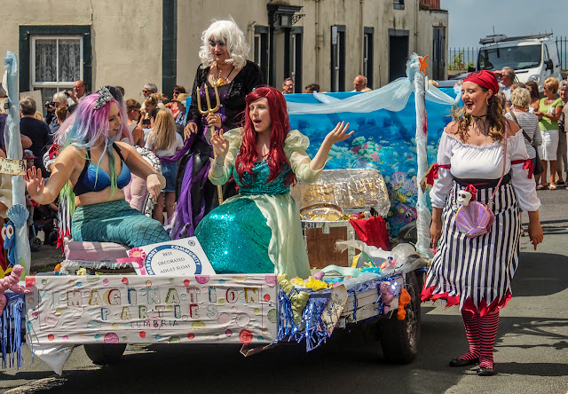 Photo of a mermaids and pirates float at Maryport Carnival