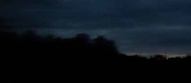 image of a dark landscape, with blurry trees on the horizon, from the cover of Rajni's book Experiments in Listening