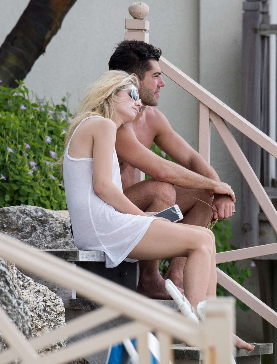 Lottie Moss goes braless on vacation with boyfriend