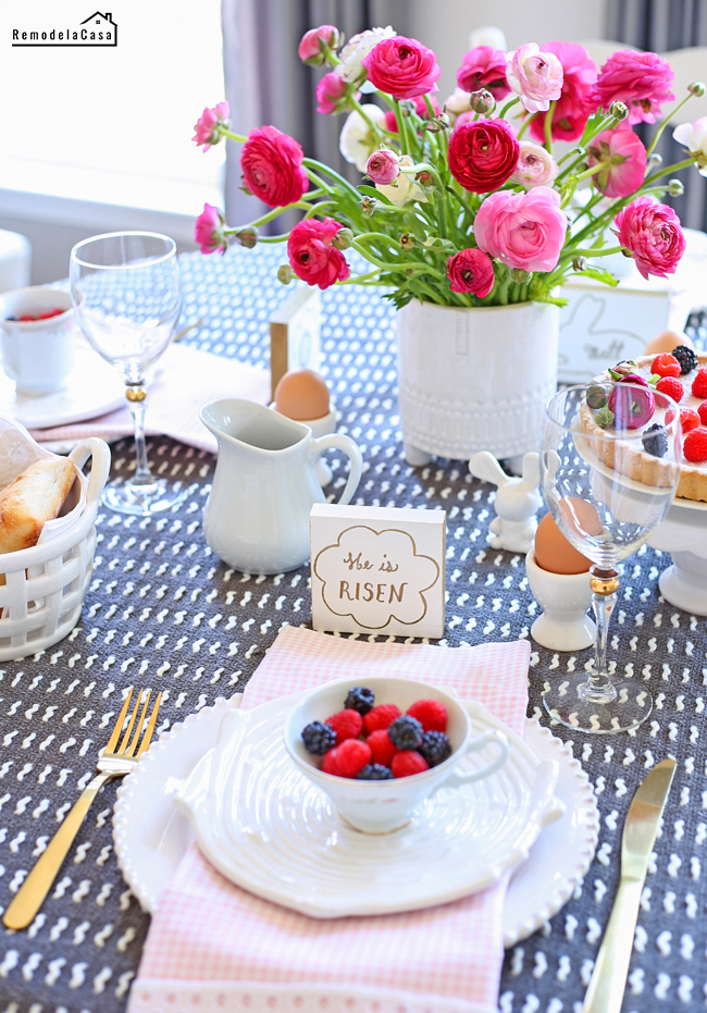 white, grey and pink Easter table with ranunculus and berries