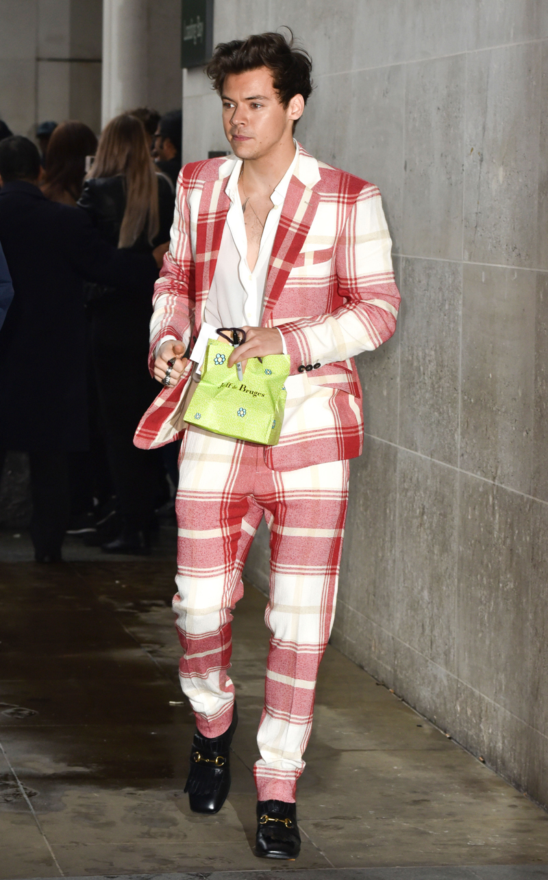 Harry Styles steps out in London with an interesting suit choice (REX/Shutterstock)