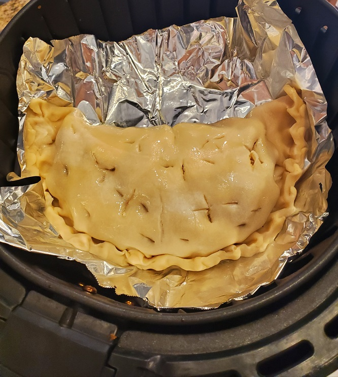 this is filled raw pie dough on foil in the air fryer