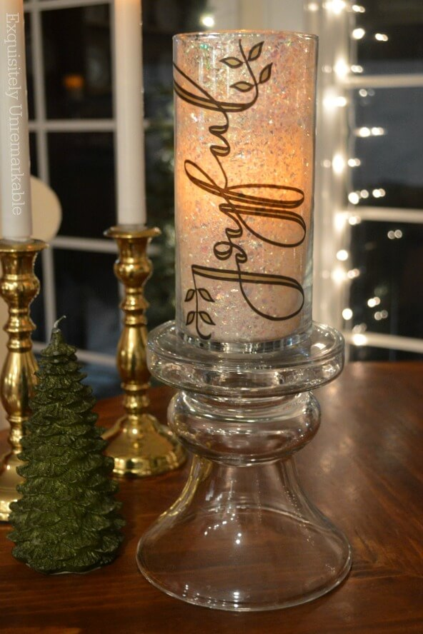 Glitter Candle DIY that says Joyful on table with candles