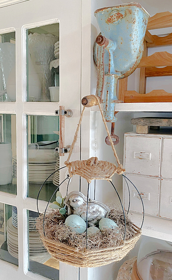 basket with eggs hanging on hutch