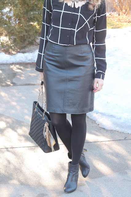 Black windowpane button up, leather skirt, black booties, and black Greg Michaels tote